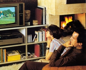 boy and man watch betamax on tv