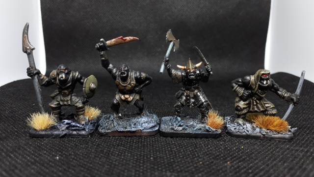 Four orcs from different manufacturers