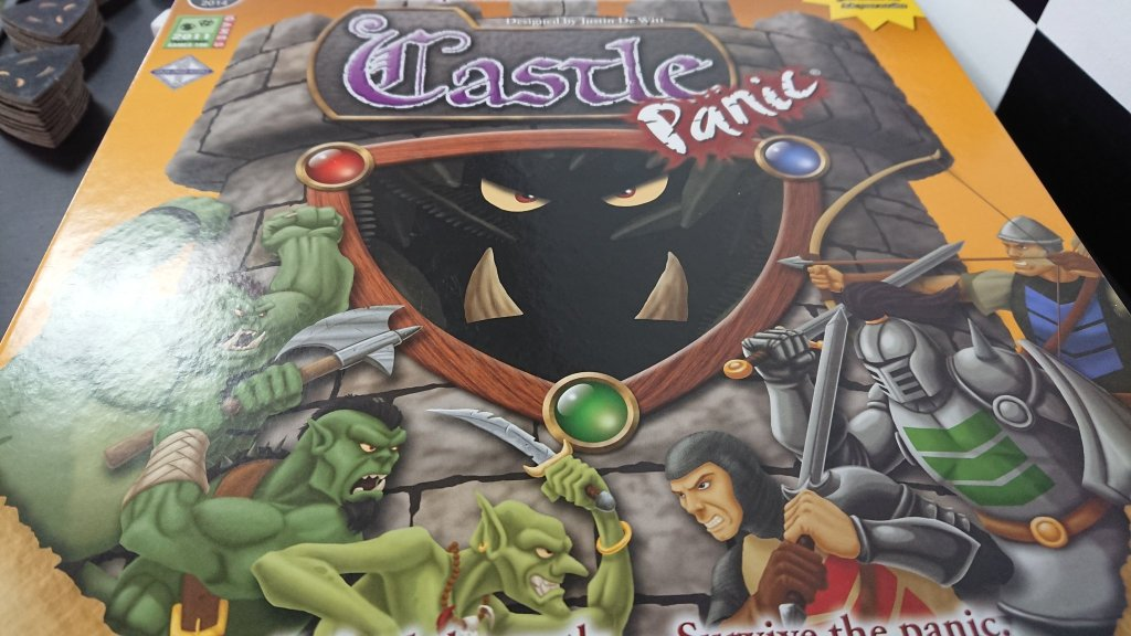 Castle Panic Fireside Games Cover Art, Orcs and Knights in Combat