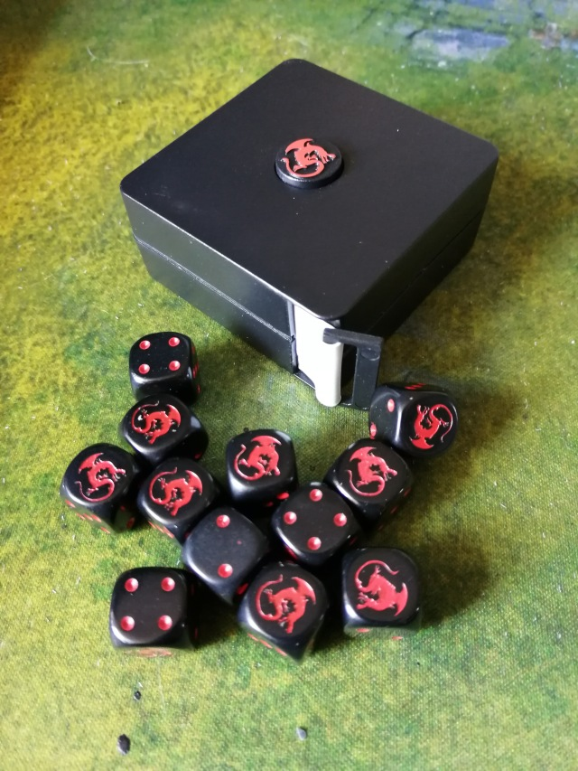 Black dice & tape measure with Red Rackham Dragon logo
